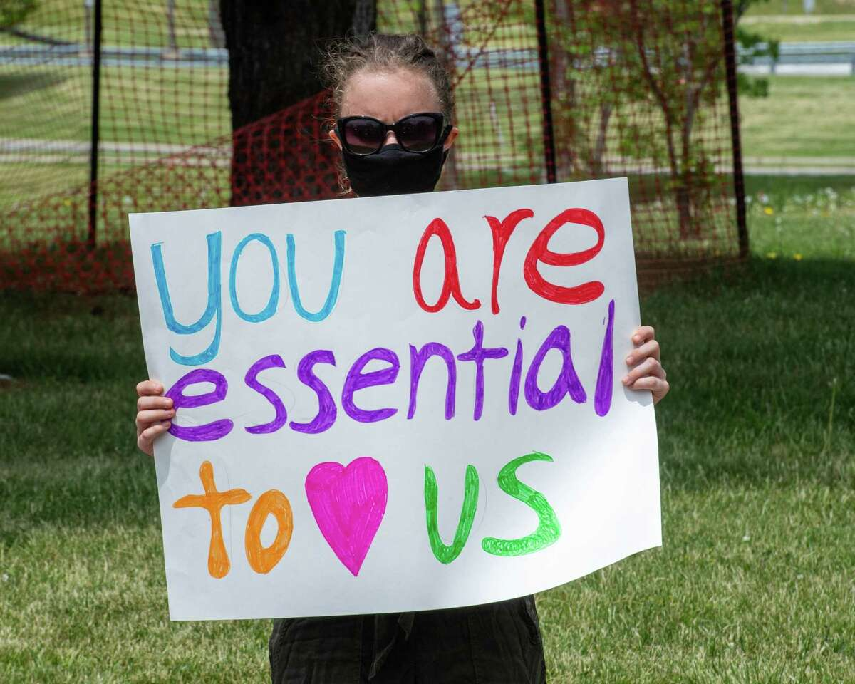 Michelle Polacinski, of ADAPT Capital Region, holds a sign during a vigil at Shaker Place Rehabilitation and Nursing in Colonie NY on Saturday, May 23, 2020 calling on New York state to support nursing home workers, transfer residents who so choose to safer settings and step up state regulations of nursing homes (Jim Franco/Special to the Times Union.)