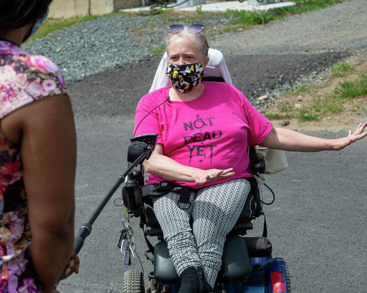 Jamie Farrar, of ADAPT Capital Region, answers questions during a vigil at Shaker Place Rehabilitation and Nursing in Colonie NY on Saturday, May 23, 2020 calling on New York state to support nursing home workers, transfer residents who so choose to safer settings and step up state regulations of nursing homes (Jim Franco/Special to the Times Union.)