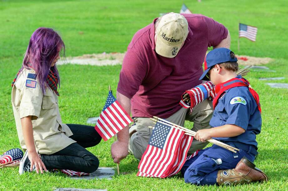 To honor our veterans on Memorial Day, members of five area scout troops combined their efforts to place about 6000 flags on the graves of veterans at Forest Lawn Memorial Park on Saturday morning. Photo made on May 23, 2020.  Fran Ruchalski/The Enterprise Photo: Fran Ruchalski, The Enterprise / The Enterprise / © 2020 The Beaumont Enterprise