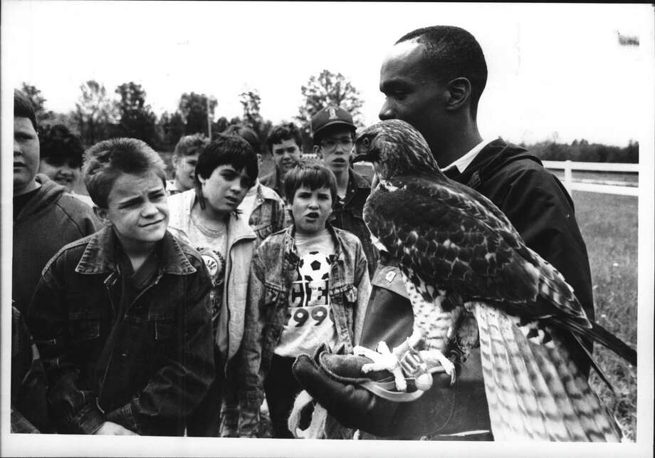 4-H training center, Middleline Road, Ballston Spa, New York - Leigh Foster, a student at Shenendehowa and a falconer, shows off a red tail hawk to a group of 5th grade students from the Harrison Avenue Elementary School in South Glens Falls as part of the 4-H Conservation Field Day held at the 4-H training center on Middleline Road in Ballston Spa. May 23, 1990 (Paul D. Kniskern, Sr./Times Union Archive) Photo: Paul D. Kniskern, Sr. / Times Union