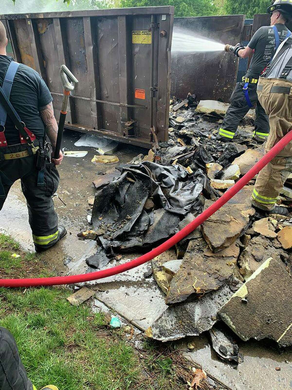 Units on scene at a dumpster fire in Trumbull, Conn., on Friday, May 23, 2020.
