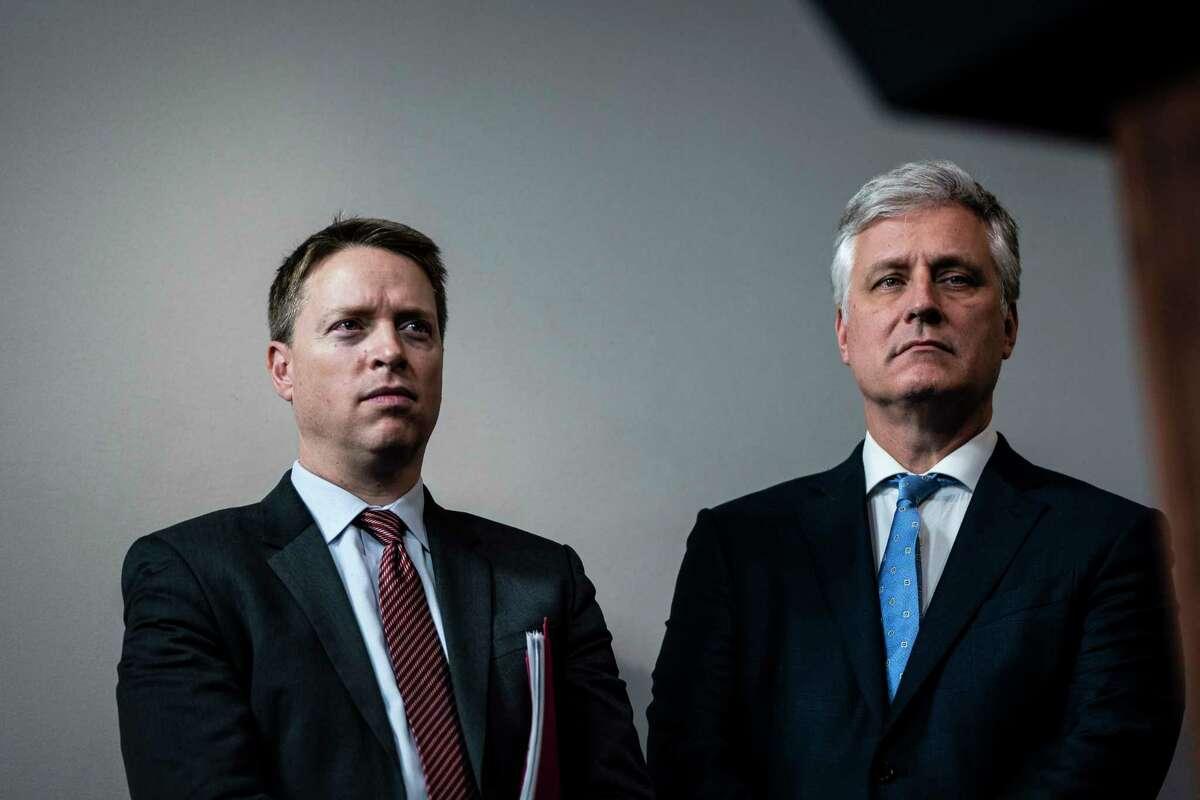 Deputy national security adviser Matthew Pottinger (left) and national security adviser Robert O'Brien attend a coronavirus briefing on Jan. 31, 2020.