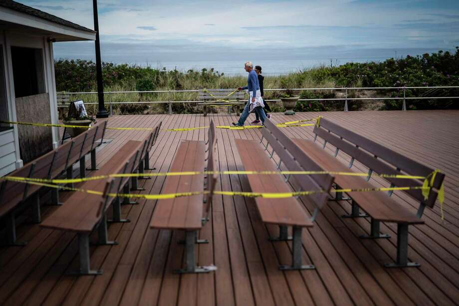 Benches along Ocean Grove Beach in New Jersey have been wrapped in yellow crime tape to encourage social distancing. Photo: Washington Post Photo By Jabin Botsford / The Washington Post