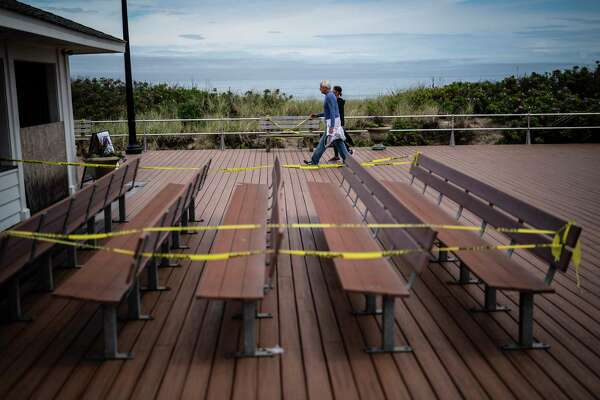 Benches along Ocean Grove Beach in New Jersey have been wrapped in yellow crime tape to encourage social distancing.