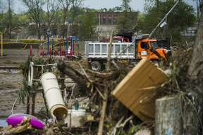 Sanford residents and business owners continue to clear debris, water and mud from the downtown area Saturday, May 23, 2020. (Katy Kildee/kkildee@mdn.net)