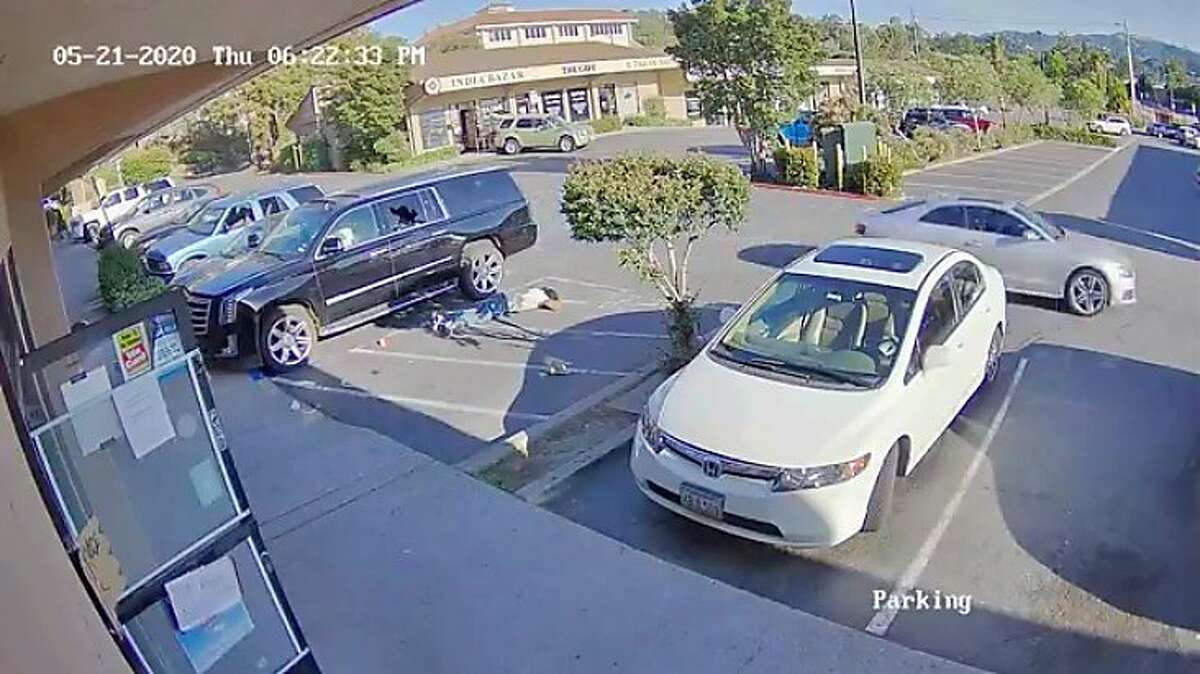 In the screenshot from surveillance footage released by Walnut Creek Police Department, a light-colored sedan can be seen driving away from the scene of a shooting on the 1200 block of Newell Avenue in Walnut Creek, Calif. Police said a shooting occurred at 6:22 p.m. on Thursday, May 21, 2020.