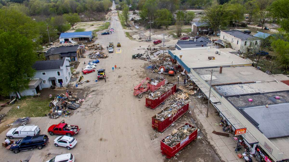 Aerial photographs show the scene in downtown Sanford Saturday, May 23, 2020 as efforts continue to clear debris and assess flood damage. (Adam Ferman/for the Daily News)