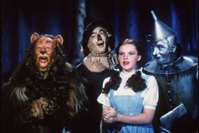 """Follow the yellow brick road to a world of vintage screen glamour with Bert Lahr (left), Ray Bolger, Judy Garland and Jack Haley in """"The Wizard of Oz."""""""
