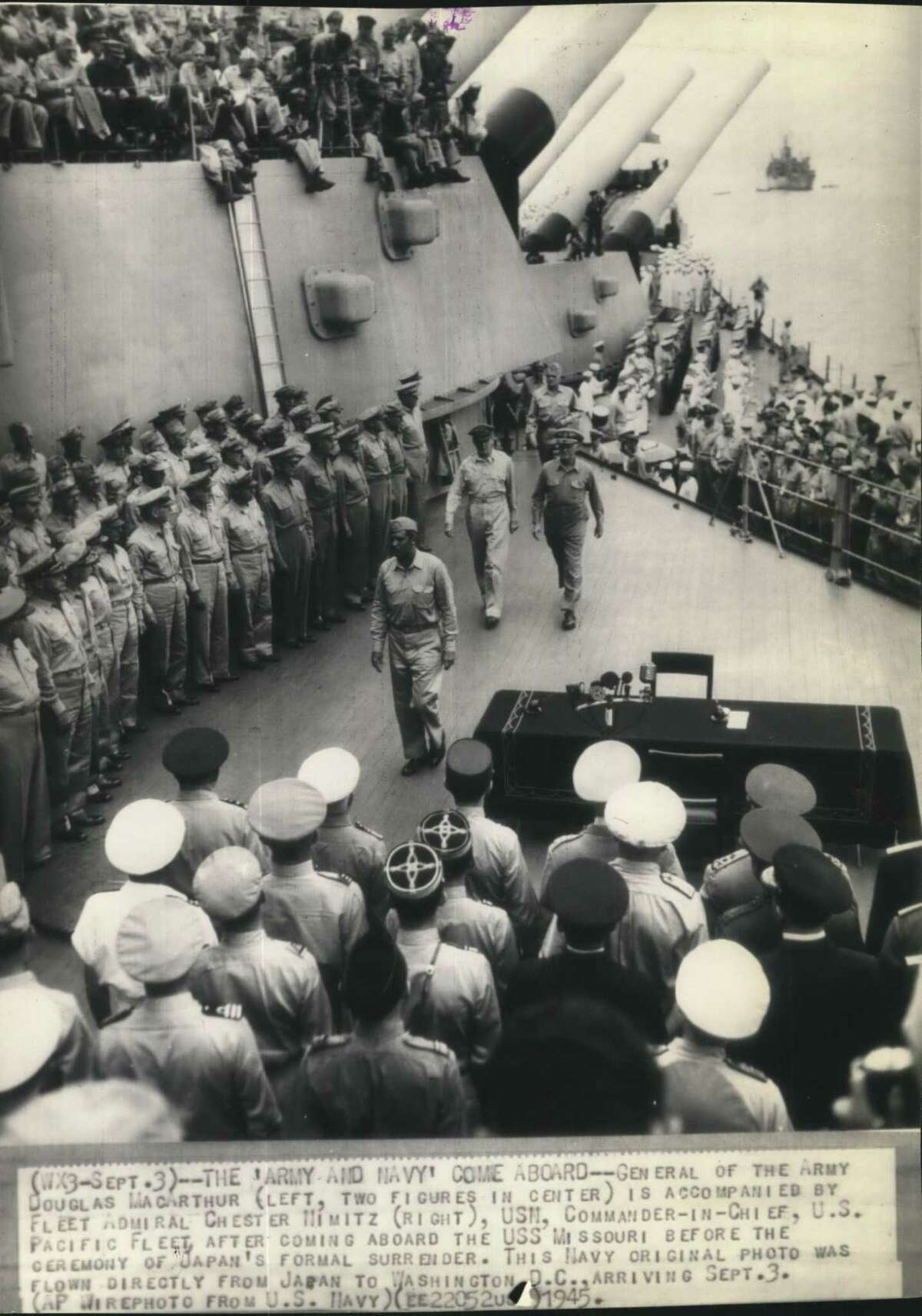 World War II - surrender - Japan - General of the Army Douglas MacArthur (left, two figures in center) is accompanied by Fleet Admiral Chester Nimitz (right), USN, Commander-in-Chief, US Pacific Fleet, after coming aboard the USS Missouri before the ceremony of Japan's formal surrender. This Navy original photo was flown directly from Japan to Washington DC, arriving September 3