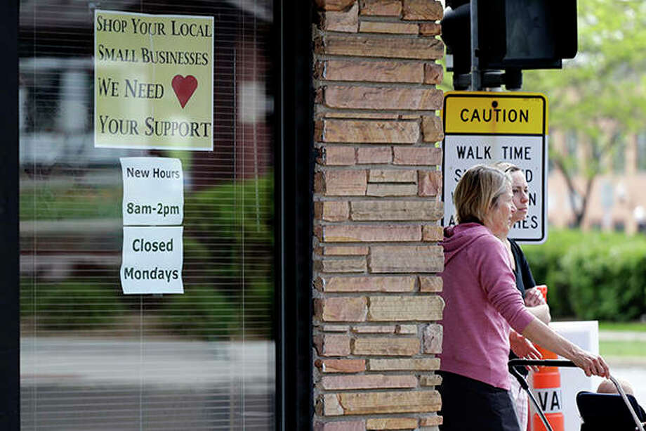 Signs are displayed at a restaurant to promote local businesses during COVID-19 restrictions. Photo: Nam Y. Huh | AP
