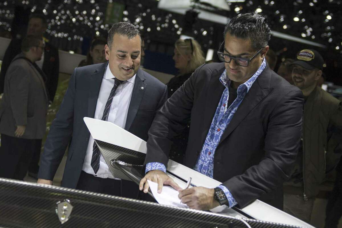 Kris Singh signs to buy a new Koenigsegg Jesko hypercar on the opening day of the 89th Geneva International Motor Show on March 5, 2019.