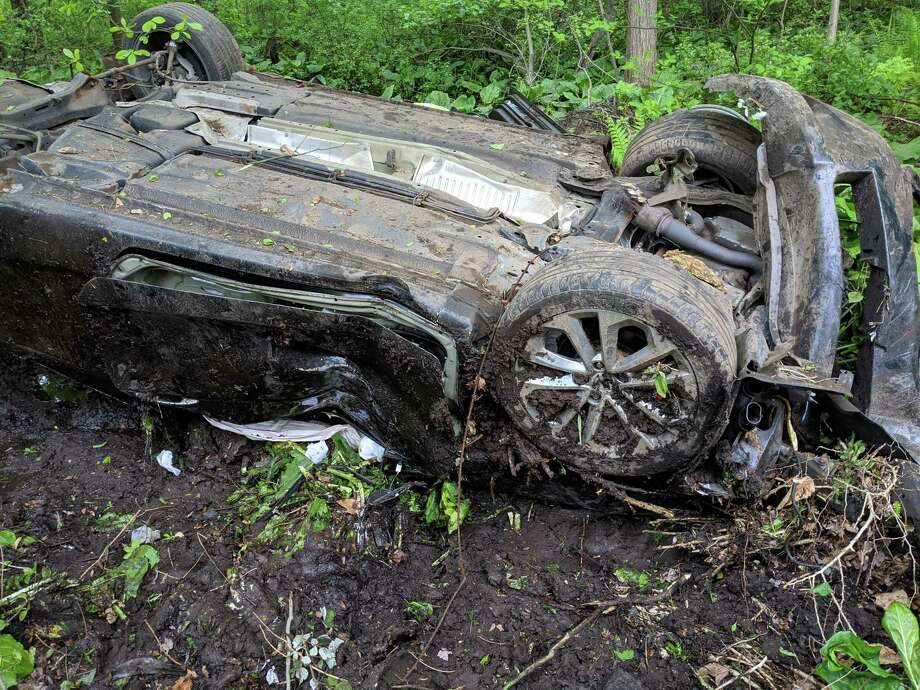 Westport Assistant Fire Chief Matthew Cohen said the vehicle was found approximately 50 feet in the woods among heavy brush and mud. It was reported that the three occupants of the vehicle were possibly ejected from the vehicle. Photo: Westport Fire Department Photo