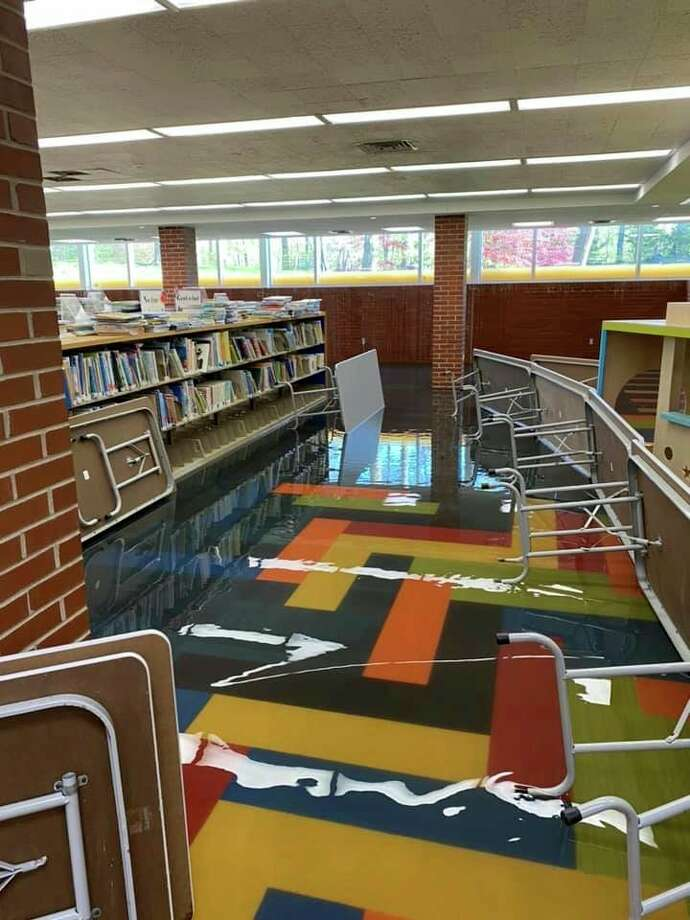 Water streams into the lower level of the Grace A. Dow Memorial Library on Thursday, May 21. (Photo provided/Facebook)