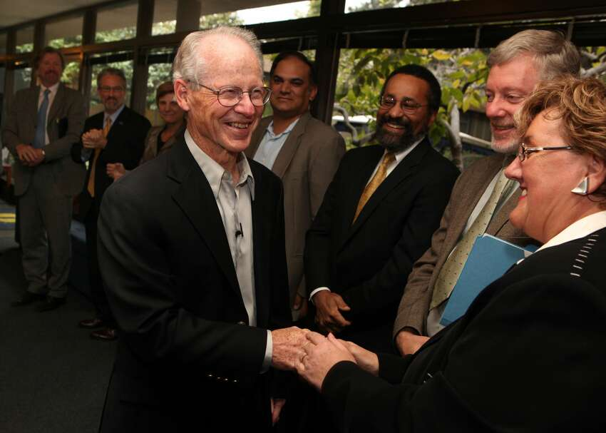 FILE: University of California, Berkeley professor Oliver Williamson (L) is greeted by colleagues at UC Berkeley October 12, 2009 in Berkeley, California. American Oliver Williamson shared the Nobel Prize in economics with Elinor Ostrom for their analysis of economic governance. (Photo by Justin Sullivan/Getty Images)
