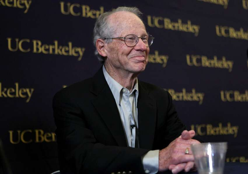 FILE: University of California, Berkeley professor Oliver Williamson smiles during a news conference at UC Berkeley October 12, 2009 in Berkeley, California. American Oliver Williamson shared the Nobel Prize in economics with Elinor Ostrom for their analysis of economic governance. (Photo by Justin Sullivan/Getty Images)