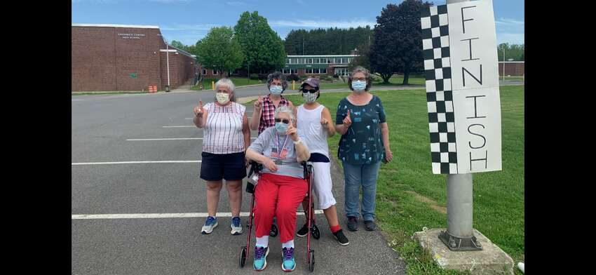 Janet Aldous, 87, of Greenwich completed the virtual Freihofer's Run for Women in 51 minutes on May 23, 2020, pushed by, from left, her daughters Theresa Aldous, Gina Snell, Ingrid Darling and Katie Cosey. (Courtesy photo)