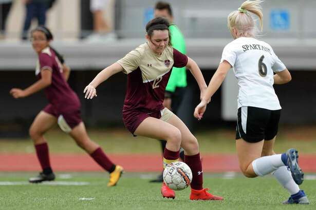 Magnolia West's Brooke Brown (12) dribbles the ball as Porter defender Breonna Bowden (6) defends in the second period of a match during the Kat Cup soccer tournament at Berton A. Yates Stadium, Thursday, Jan. 9, 2020, in Willis.