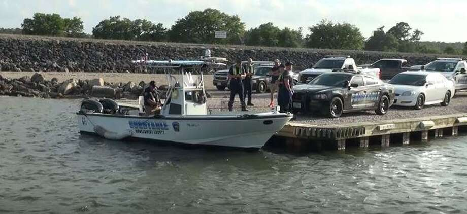 A boat with the Montgomery County Precinct 1 Constable's Office is seen on parked at a pier on Lake Conroe as authorities on Saturday search for a man who drowned. Photo: Courtesy Of The Montgomery County Police Reporter