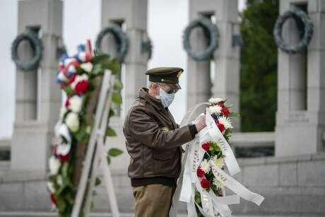 Vietnam War veteran C. Patrick McCourt participates in a wreath-laying ceremony this month to mark the 75th anniversary of the Allied victory in Europe at the National World War II Memorial in Washington, D.C.