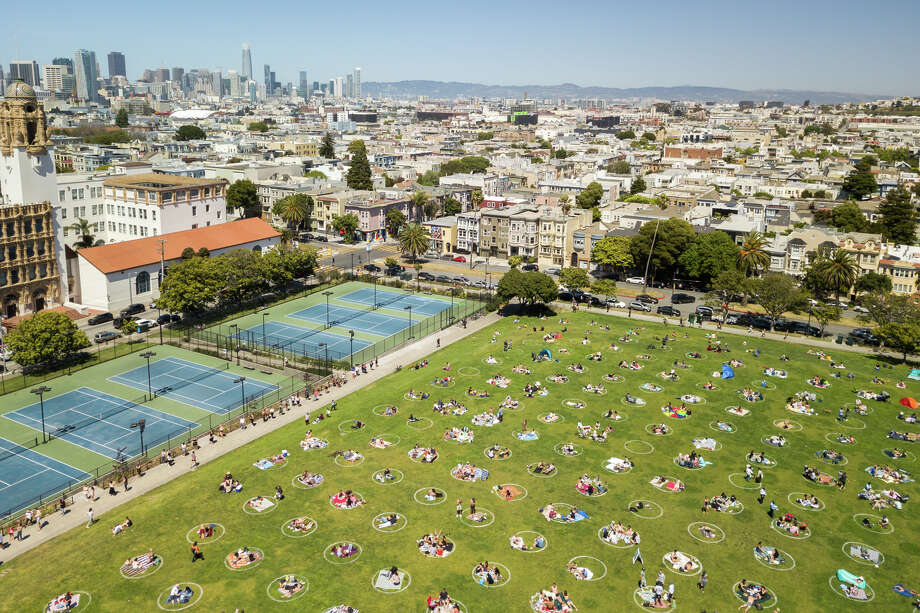 A very crowded Dolores Park photographed Saturday, May 24, 2020. Despite massive groups flocking to parks and beaches over the weekend, the San Francisco Police Department issued no citations for shelter-in-place order violations. Photo: Patricia Chang, Special To SFGate / Patricia Chang