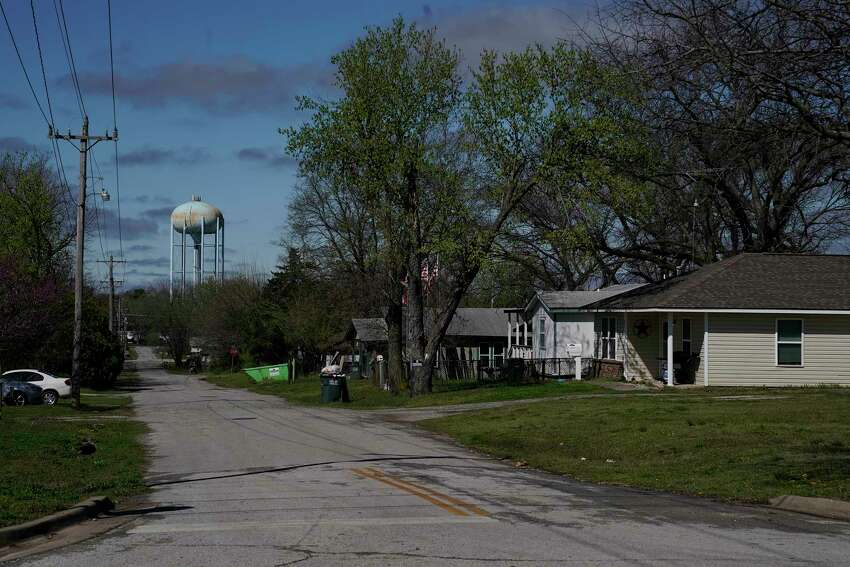 A water tower looms over a neighborhood in Bristow, Okla., March 24.