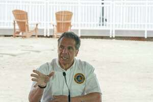 New York Governor Andrew Cuomo speaks at a press conference at the Theater at Jones Beach on May 24, 2020 on Long Island. - Parts of the state that saw fewer virus cases have already begun to ease lockdown restrictions, but they have yet to be lifted in New York City, the former virus epicenter in the US. The city's beaches will remain closed for this long Memorial Day weekend, which traditionally marks the beginning of the US summer season. (Photo by Bryan R. Smith / AFP)