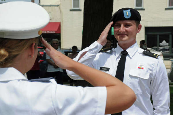 Newly-commissioned 2nd Lt. Gabriel Parish, right, receives his first salute from West Point Cadet Brooke Tuttle of Jerseyville during Saturday's ceremony at the Jersey County Courthouse. Parish is scheduled to join other graduating cadets at a June 13 ceremony with President Donald Trump at West Point.
