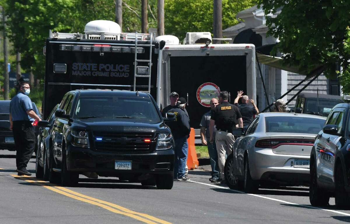 A file photo of local and state police investigating one of the crimes allegedly committed by Peter Manfredonia in Connecticut in late May 2020.