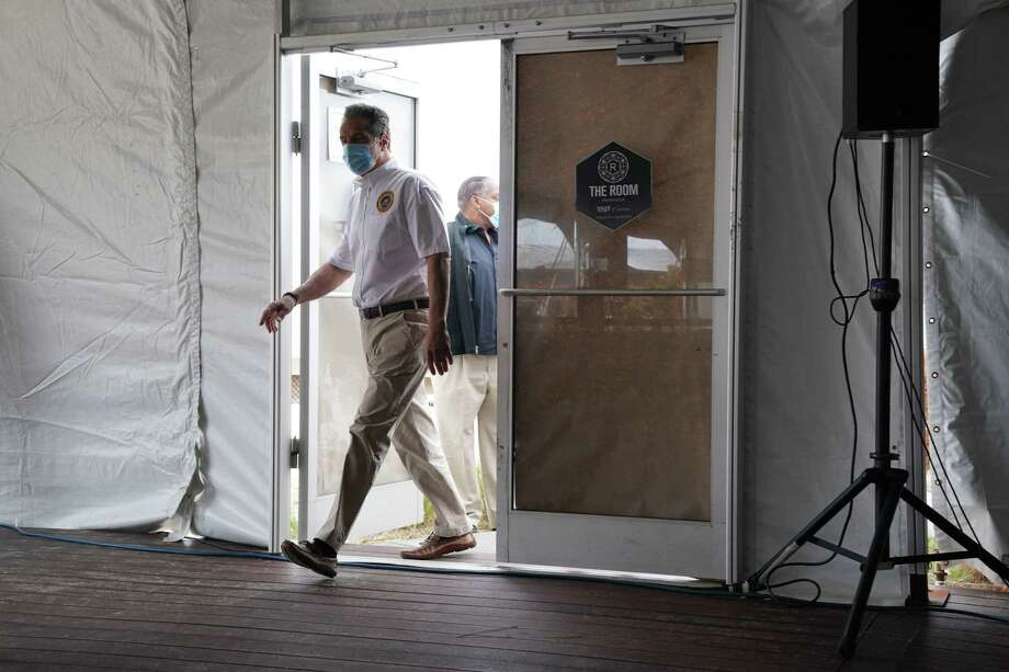 New York Governor Andrew Cuomo arrives for a press conference at the Theater at Jones Beach on May 24, 2020 on Long Island, New York. - Parts of the state that saw fewer virus cases have already begun to ease lockdown restrictions, but they have yet to be lifted in New York City, the former virus epicenter in the US. The city's beaches will remain closed for this long Memorial Day weekend, which traditionally marks the beginning of the US summer season. (Photo by Bryan R. Smith / AFP) (Photo by BRYAN R. SMITH/AFP via Getty Images) Photo: BRYAN R. SMITH / AFP Via Getty Images / AFP or licensors