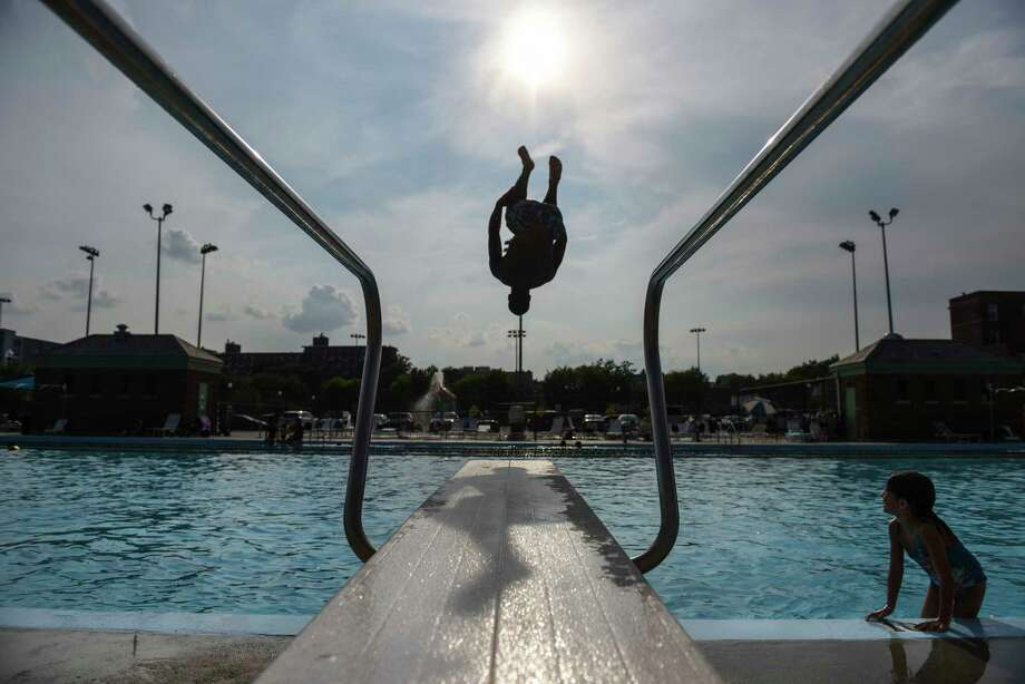 Demarcus Cooper does a flip off the diving board at the Banneker Pool in Washington in 2018. Photo: Washington Post Photo By Michael Robinson Chavez / The Washington Post
