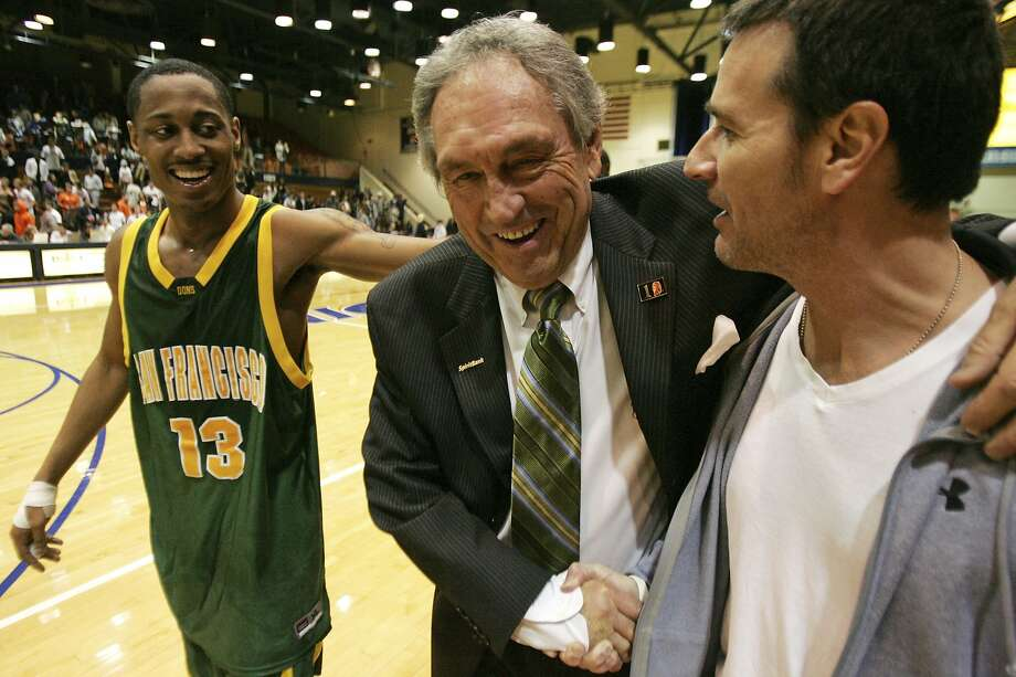 FILE - In this Saturday, Feb. 2, 2008, file photo, San Francisco head coach Eddie Sutton shakes the hand of Terry Anzaldo as Myron Strong, left, smiles after San Francisco defeats Pepperdine 88-85 in an NCAA college basketball game to give Sutton his 800th win, in Malibu, Calif. Sutton, the Hall of Fame basketball coach who led three teams to the Final Four and was the first coach to take four schools to the NCAA Tournament, died Saturday, May 23, 2020. He was 84. (AP Photo/Jeff Lewis, File) Photo: Jeff Lewis, Associated Press