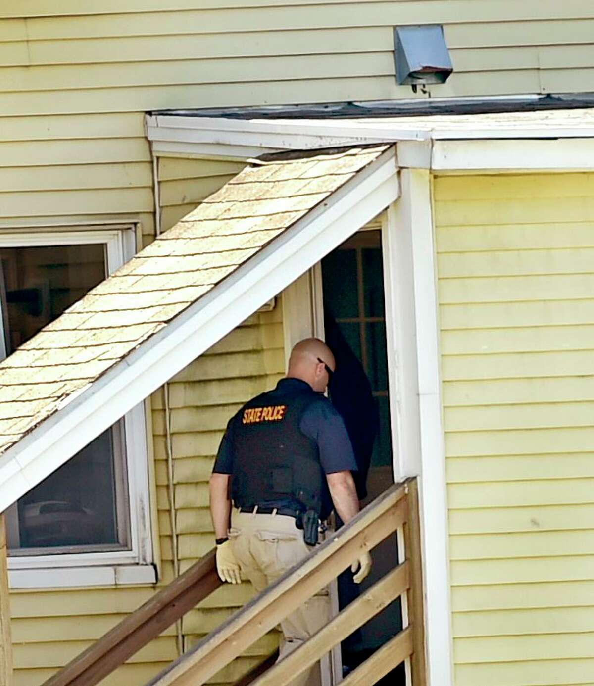 Derby, Connecticut - Sunday, May 24, 2020: Connecticut State Police enters a house on Roosevelt Drive in Derby Sunday afternoon where a male was found deceased in the house during the search for suspected murder Peter Manfredonia, 23, described as armed and dangerous. State Police said Manfredonia is believed to be armed with pistol and long guns. Manfredonia is wanted in a homicide and serious assault in northeastern Connecticut.