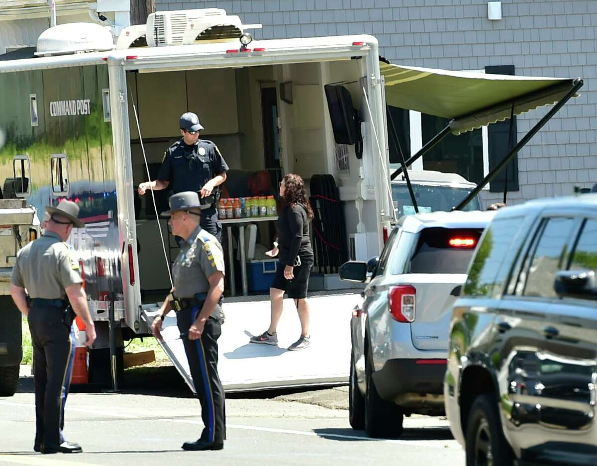Derby, Connecticut - Sunday, May 24, 2020: Connecticut State Police and Derby Police at a Command Post in front of a house on Roosevelt Drive in Derby Sunday afternoon where a male was found deceased in the house during the search for suspected murder Peter Manfredonia, 23, described as armed and dangerous. State Police said Manfredonia is believed to be armed with pistol and long guns. Manfredonia is wanted in a homicide and serious assault in northeastern Connecticut.