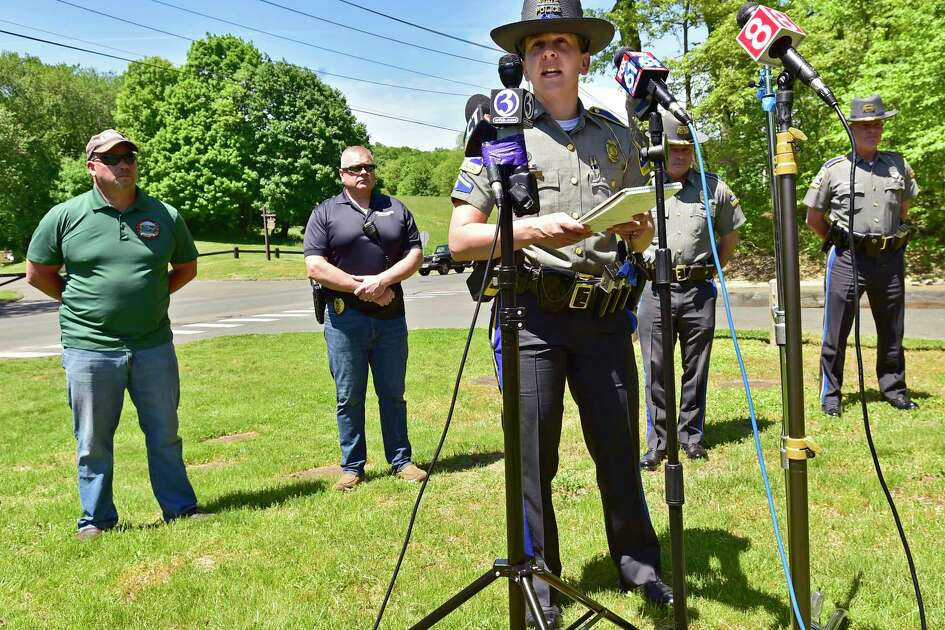 Derby, Connecticut - Sunday, May 24, 2020: Connecticut State Trooper First Class Christine Jeltema briefs the media on the search for suspected murder Peter Manfredonia, 23, wanted in a homicide and serious assault in northeastern Connecticut, during a press conference Sunday afternoon at Derby H.S. Manfredonia is described as armed and dangerous and believed to be armed with pistol and long guns. Manfredonia is