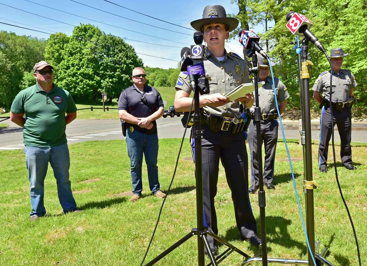 State Trooper Christine Jeltema briefs the media on the search for Peter Manfredonia, 23, during a press conference Sunday in Derby.