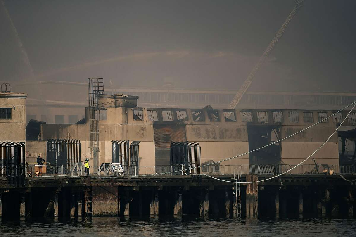 A partially collapsed structure is seen during a four alarm structure fire at Pier 45 in San Francisco, Calif. on Saturday, May 23, 2020.