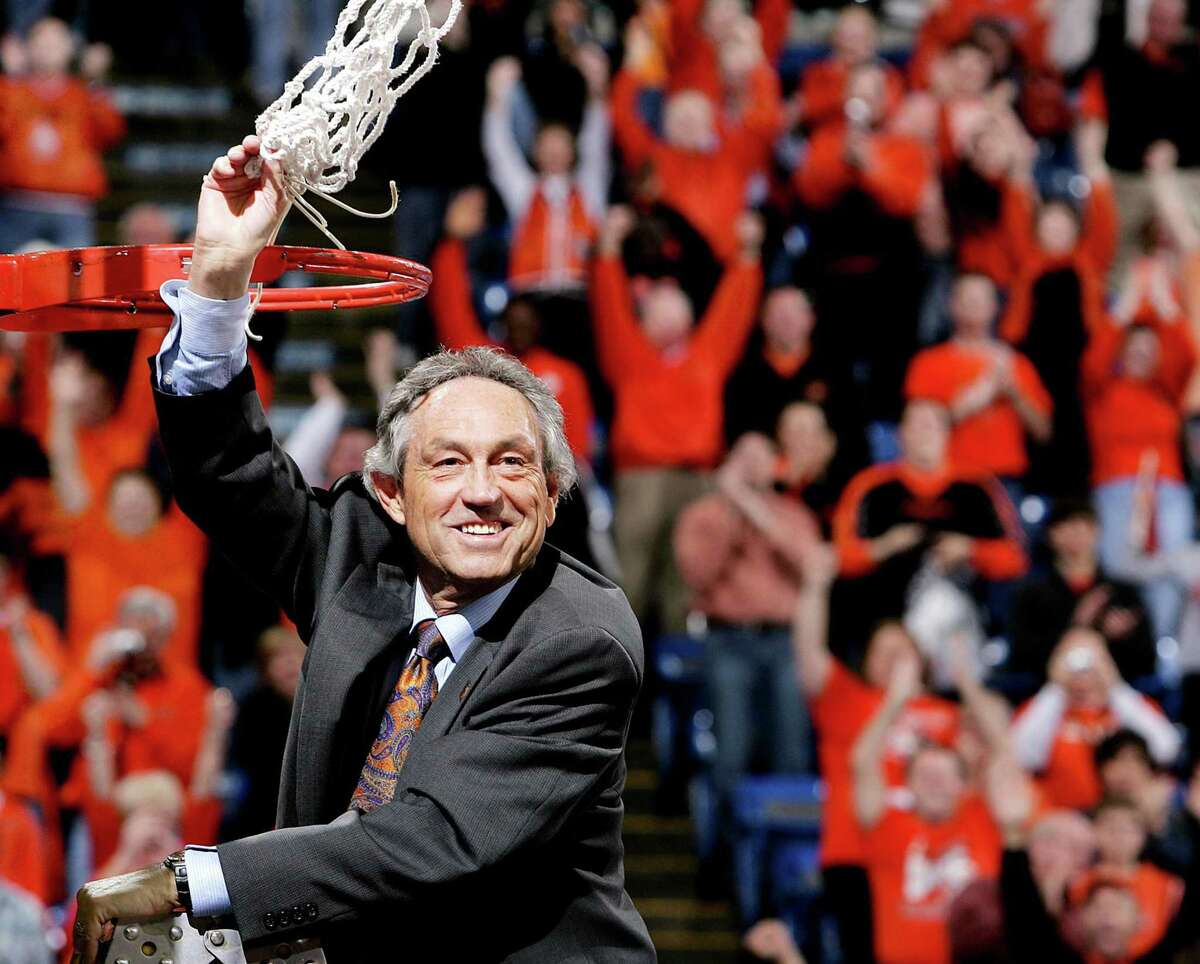 In 2005, Oklahoma State head coach Eddie Sutton celebrates his team's victory in the Big 12 Tournament title game against Texas Tech in Kansas City, Mo. Sutton, who was elected to the Naismith Memorial Basketball Hall of Fame on April 4, died May 24 at his home in Tulsa at 84.