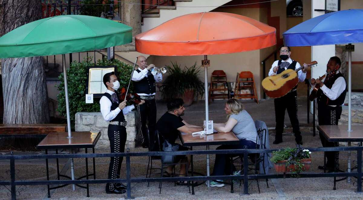 Mariachi Mexicanisimo plays for diners at Casa Rio after the restaurant reopened in San Antonio on May 18.