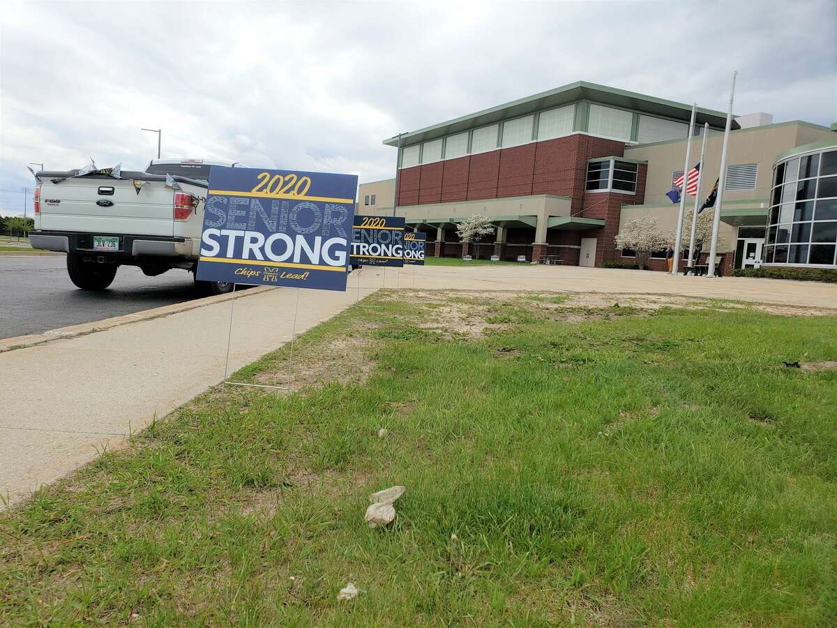 Signs supporting seniors could be seen at Manistee High School while graduating seniors walked inside for their diplomas and photos.