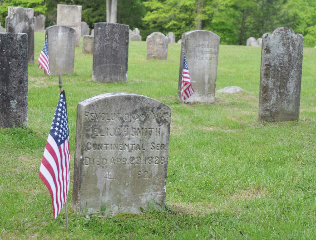The stars and stripes was placed on the final resting place of Elijah Smith, whose stone read: Revolutionary War, Continental Service, died April 28, 1828.