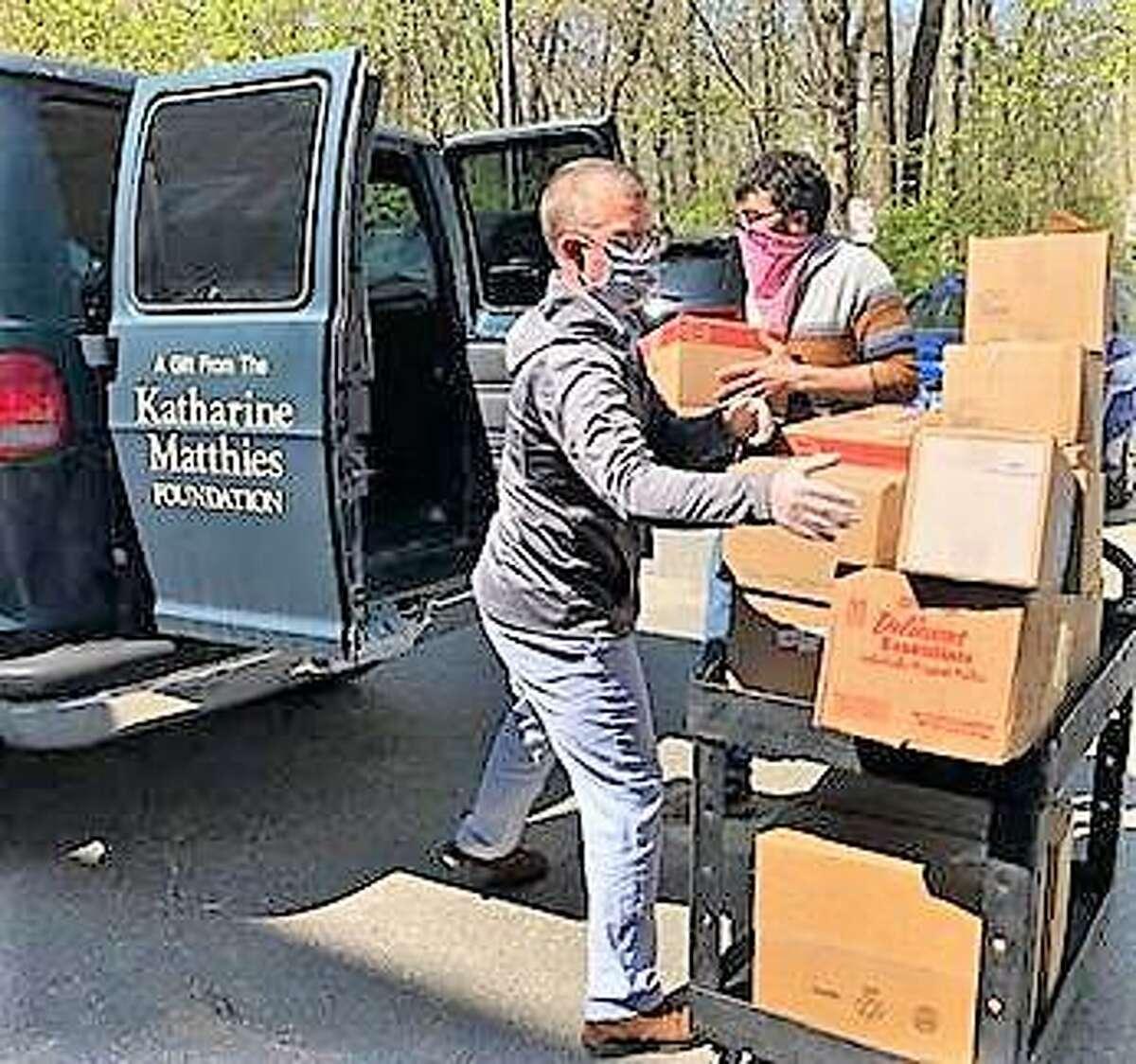TEAM President/CEO David Morgan, left, loads frozen food into a van.