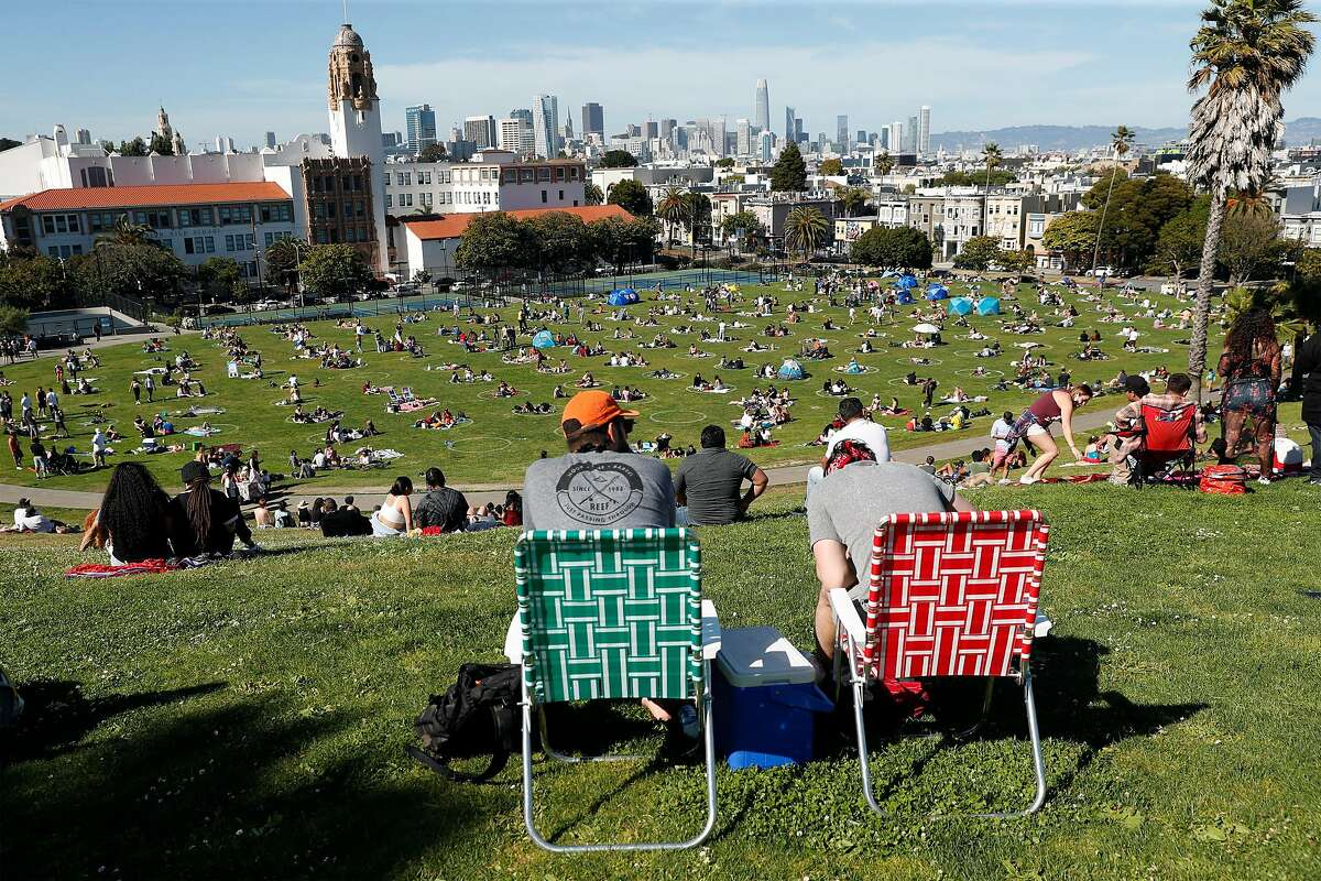 Crowds socially distance at Mission Dolores Park in San Francisco, Calif., on Sunday, May 24, 2020.