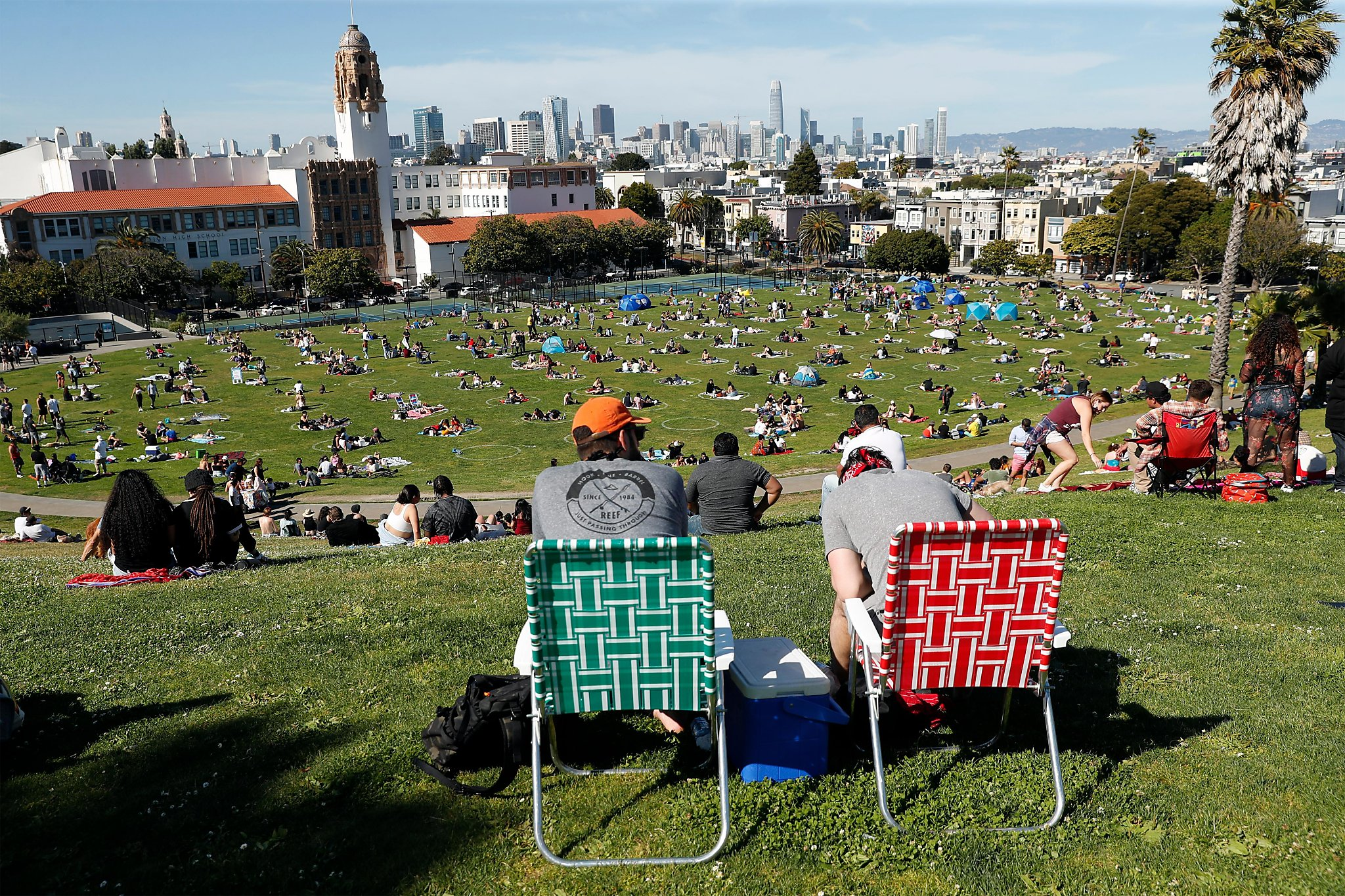 Crowds head outdoors for Memorial Day weekend, mostly keeping distance