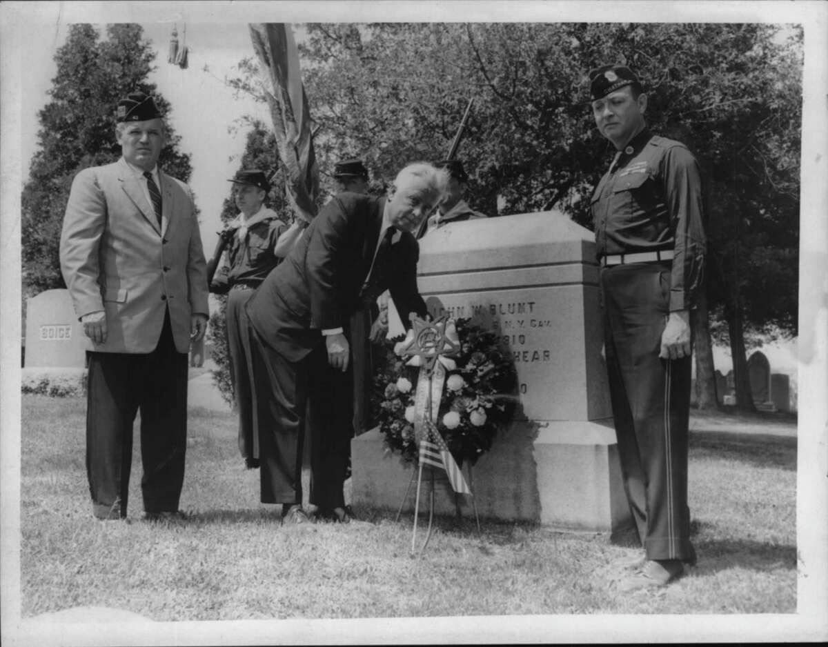 New York - Visiting the Chatham grave of Captain John V. Blunt, winner of the Congressional Medal of Honor in the Civil War, are, from left: Archie Mallon, commander of Chatham American Legion Post; Senator Kenneth B. Keating, Memorial Day speaker, and Colonel Albert S. Callan. May 31, 1962 (Knickerbocker News Staff Photo/Times Union Archive)