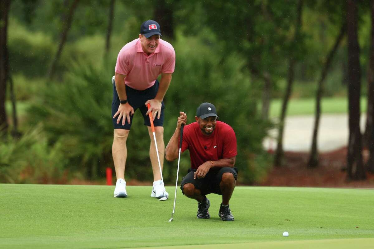 HOBE SOUND, FLORIDA - MAY 24: Tiger Woods and former NFL player Peyton Manning read a putt on the sixth green during The Match: Champions For Charity at Medalist Golf Club on May 24, 2020 in Hobe Sound, Florida. (Photo by Mike Ehrmann/Getty Images for The Match)