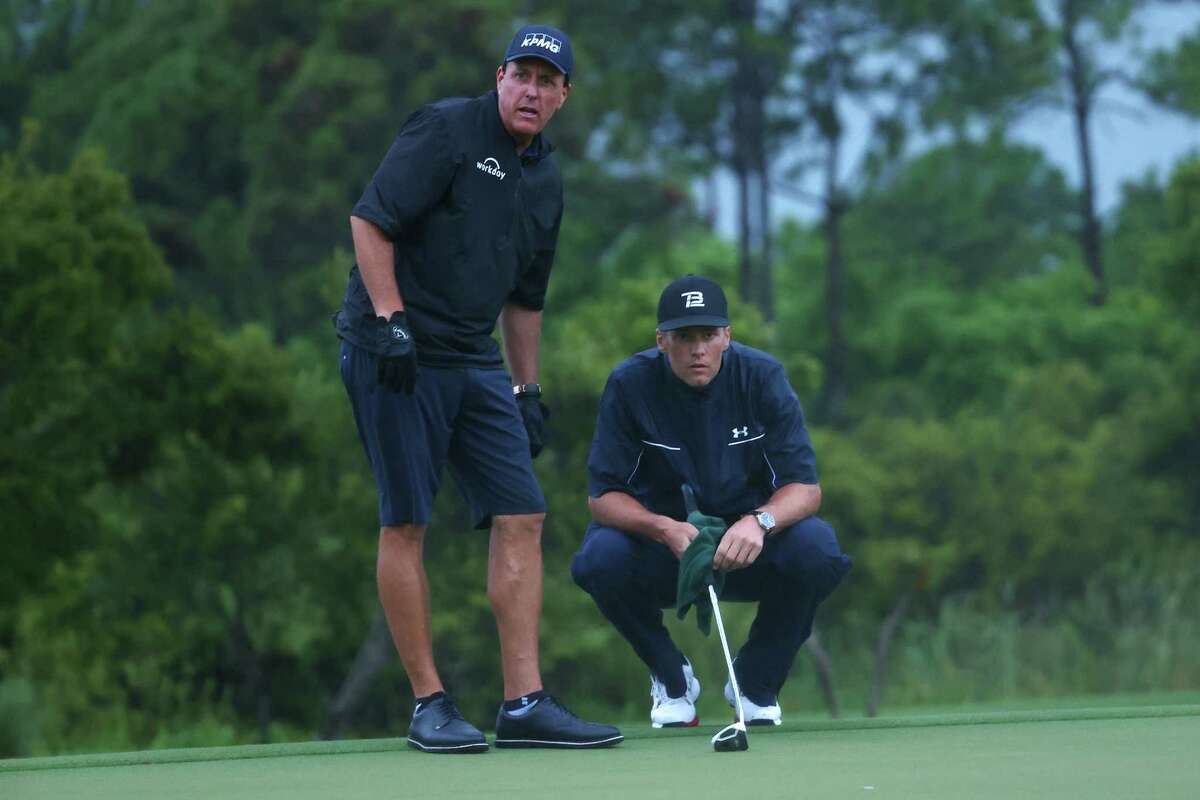 HOBE SOUND, FLORIDA - MAY 24: Phil Mickelson reads a putt for NFL player Tom Brady of the Tampa Bay Buccaneers looks on the 17th green during The Match: Champions For Charity at Medalist Golf Club on May 24, 2020 in Hobe Sound, Florida. (Photo by Mike Ehrmann/Getty Images for The Match)