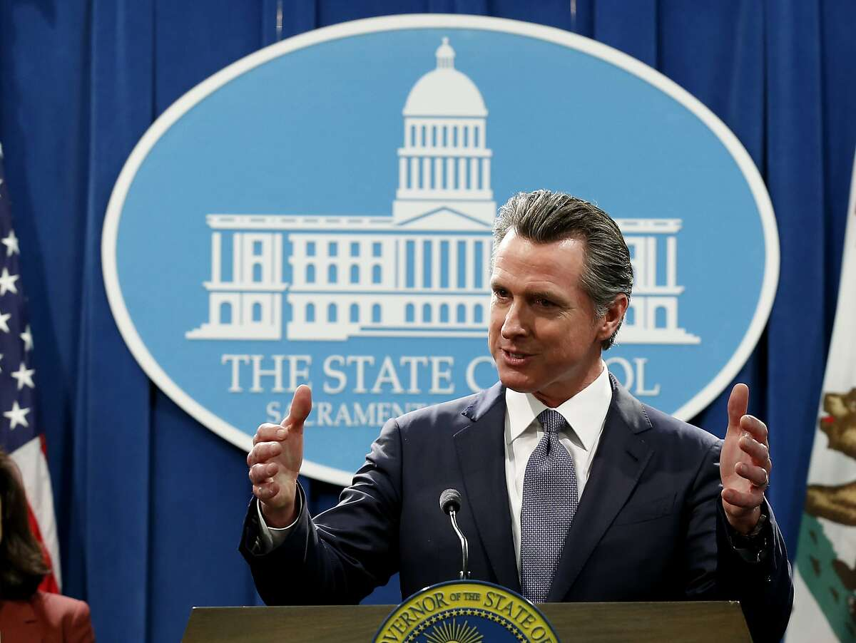 FILE - In this March 12, 2020, file photo, California Gov. Gavin Newsom speaks to reporters about his executive order advising that non-essential gatherings of more than 250 people should be canceled until at least the end of March, during a news conference in Sacramento, Calif. Newsom has approved 45 of California's 58 counties to reopen some businesses since May 8 when he loosened his original mid-March stay-at-home order. Los Angeles County, where more than 2,400 have died, is moving more cautiously, on Friday, May 22, 2020, allowing curbside pickup to resume at indoor malls. Rural Modoc County, where no cases have been reported, reopened businesses the first week of May. (AP Photo/Rich Pedroncelli, File)