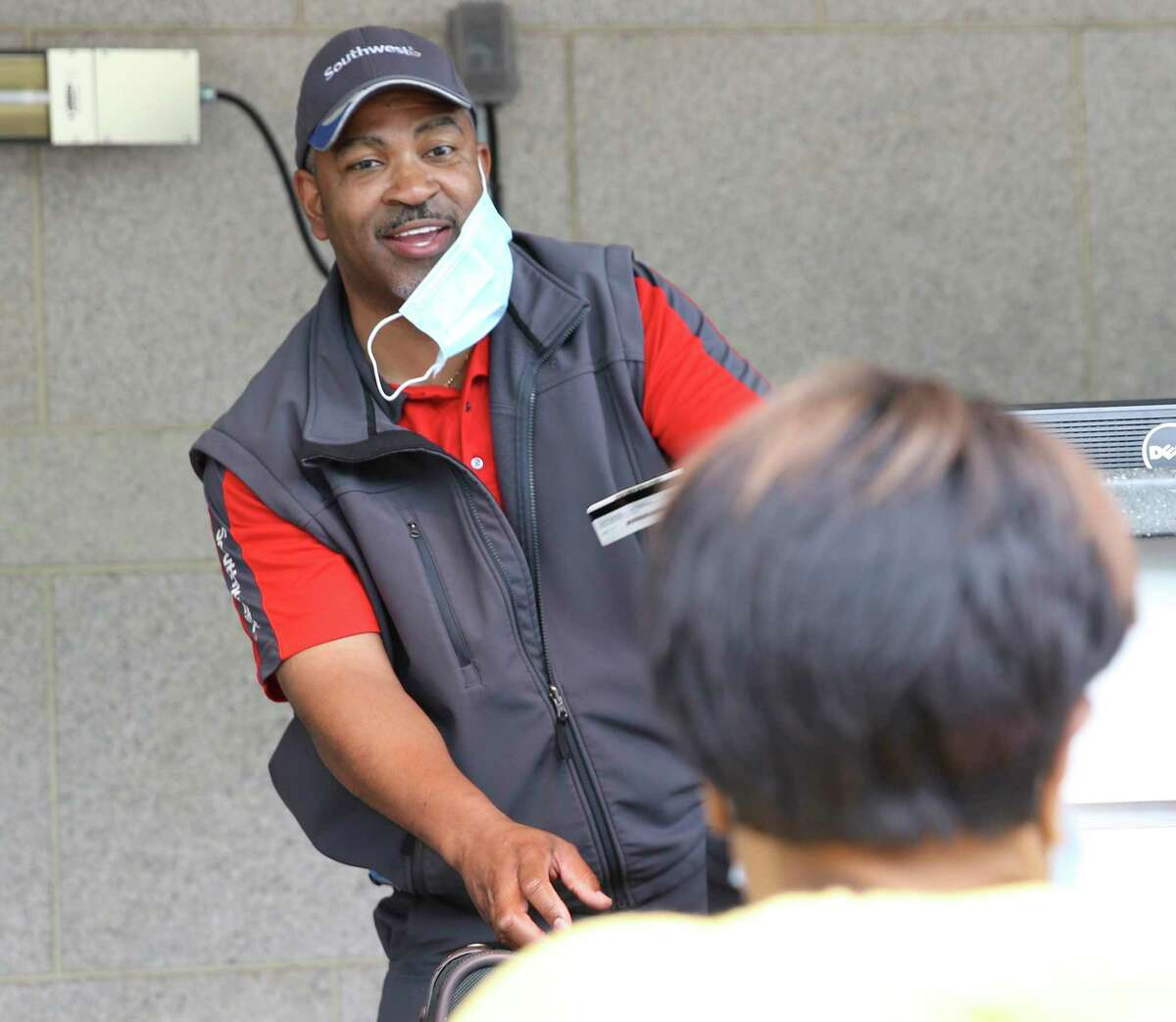 """For more than 20 years Skycap Herb Watts, nicknamed """"Herb on the Curb,"""" has brightened many passengers' day with a smile as he hefted their luggage for their flights on Southwest Airlines. On Thursday, May 7, 2020, Watts was seen helping an elderly passenger with her bags and boarding passes for her flight."""