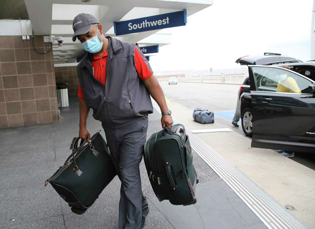 """For more than 20 years, skycap Herb Watts, nicknamed """"Herb from the Curb,"""" has brightened many days with a smile as he hefts passengers' luggage at San Antonio International Airport."""