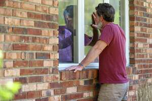 """Jack Campise talks with his mother, Beverly Kearns, through her apartment window at the Kimberly Hall North nursing home, Thursday, May 14, 2020 in Windsor, Conn. The coronavirus has had no regard for health care quality or ratings as it has swept through nursing homes around the world, killing efficiently even in highly rated care centers. Preliminary research indicates the numbers of nursing home residents testing positive for the coronavirus and dying from COVID-19 are linked to location and population density a€"""" not care quality ratings. (AP Photo/Chris Ehrmann"""